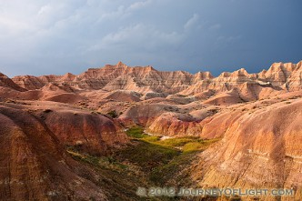 One of the things that I can say about visiting Badlands National Park in South Dakota is that the weather is almost always very dynamic when I am there. I rarely have times when it is all sunny or all cloudy. Usually, when the sun bursts forth there is some great color in the sky. During the day clouds lazily float by and then in the afternoon I am often treated to a spectacular storm. This image is from one such evening, a summer storm was rolling through and the sunlight was streaming through the clouds illuminating the badlands landscape.