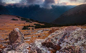 There was a chill in the air as evening descended across Rocky Mountain National Park. From the treeless tundra, the view of the valley was uninhibited while the clouds rolled across the tips of the mountains. It is during these times I fully comprehend the feelings described by John Denver in his songs.
