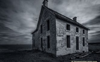 Gone Forever on the Nebraska Plains - An Abandoned Farm House Sits Alone on the Prairie