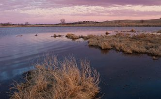 Dusk descends over a pond on the Little Salt Fork Marsh in Lancaster County near Raymond, Nebraska.