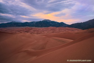 As the last of the light of the day diminishes at Great Sand Dunes National Park, a single set of clouds remain illuminated before quietly going dim.