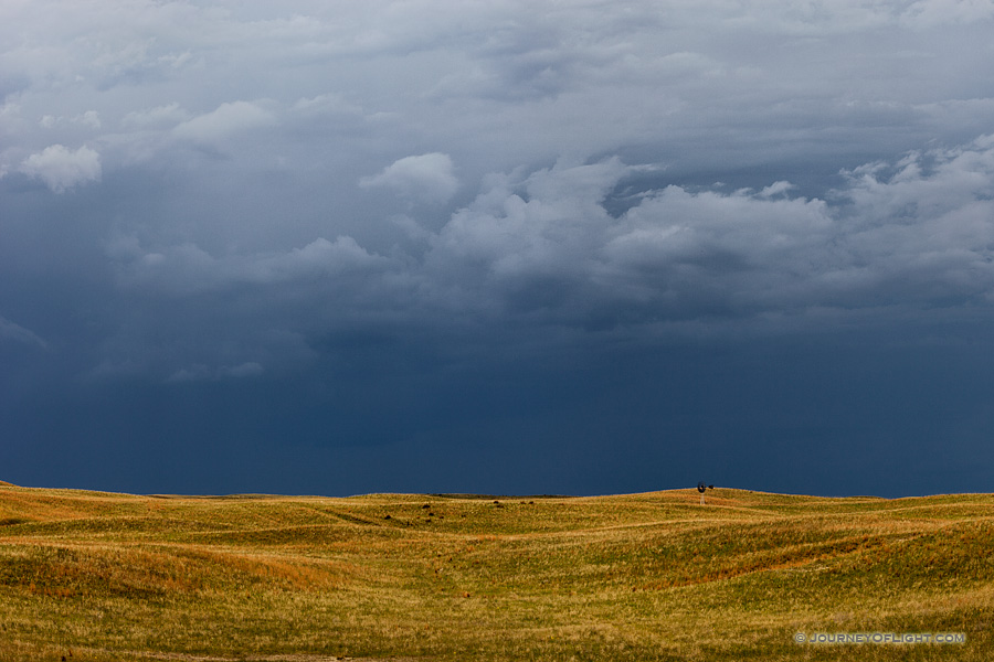 Dark clouds hover over the rolling sandhills in McKelvie National Forest. The darkness on the horizon all but extinguished the light of day on a previously sunny afternoon. I knew that beyond the dark clouds, however, the sky was still blue.