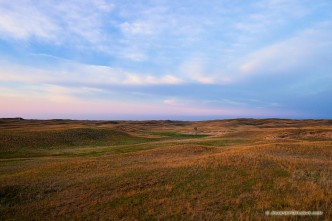 The last light of Day illuminates a windmill nesteld in the sandhills on the western edge of Halsey National Forest.