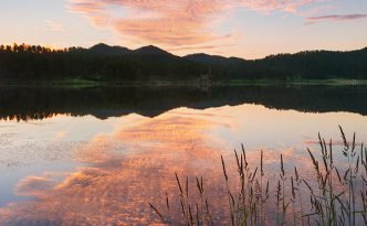 Stockade Lake in the Black Hills of South Dakota reflects the warmth of the rising sun.