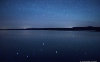 On a clear night at Niobrara State Park the stars shone brightly above the Missouri River. In the reflection of the river the Big Dipper can be clearly seen.