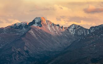 Long's Peak's western face glows with the last warm hues of sunset.