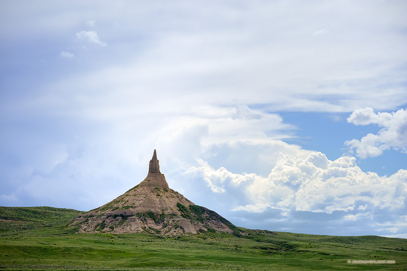 Afternoon storm clouds gather in the west billowing above Chimney Rock in the panhandle of Nebraska.