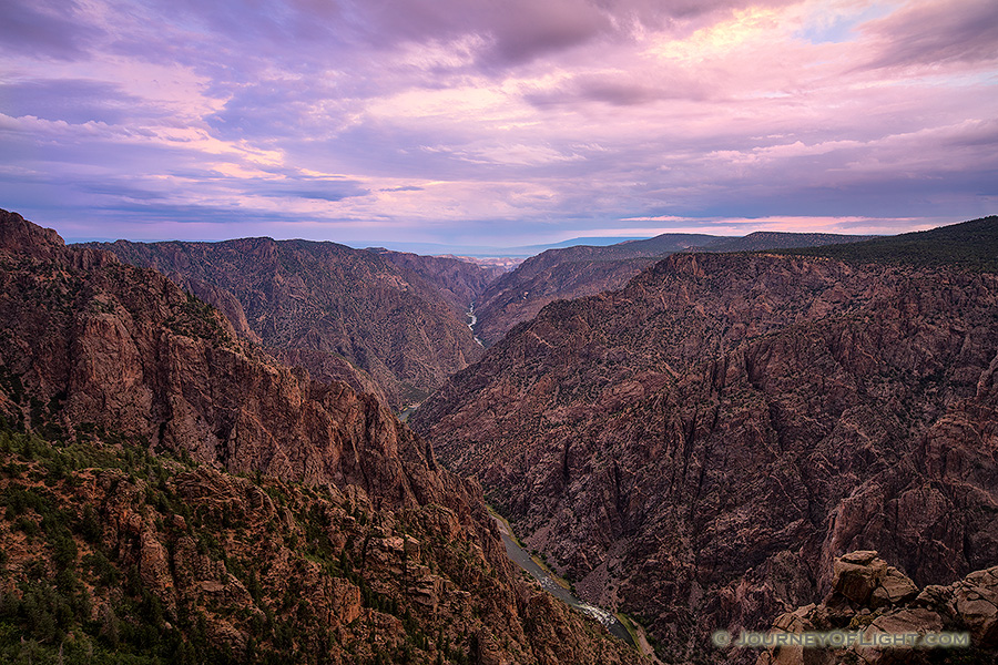 Pastel hues dominate the sky and are reflected throughout the canyon during a beautiful summer sunrise. - Colorado Photography