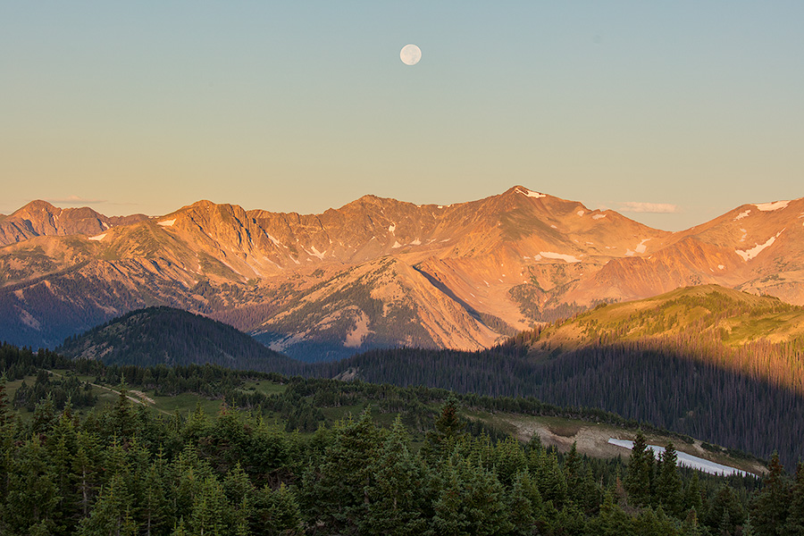 Landscape scenic photograph of the moon setting over the Never Summer Mountain Range, Rocky Mountain. - Colorado Photography