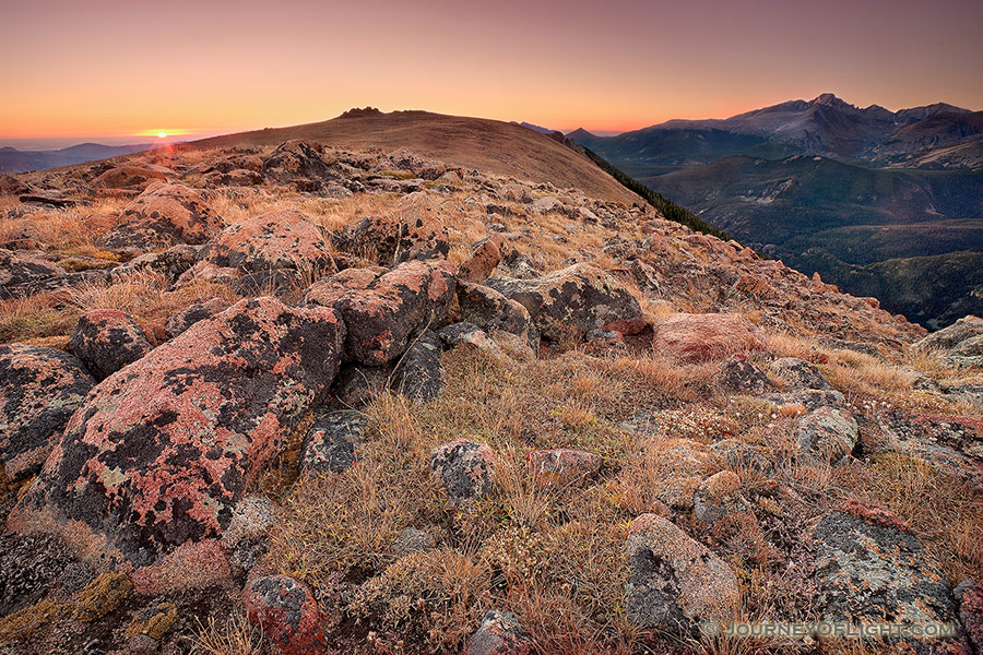 On this day, as many days through time, the exposed rocks on the tundra area of Rocky Mountain National Park bear witness to the rising sun and its illumination of Longs Peak. - Colorado Photography