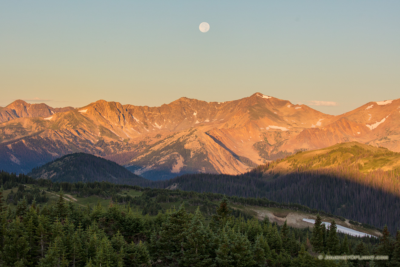 Landscape scenic photograph of the moon setting over the Never Summer Mountain Range, Rocky Mountain. - Colorado Picture