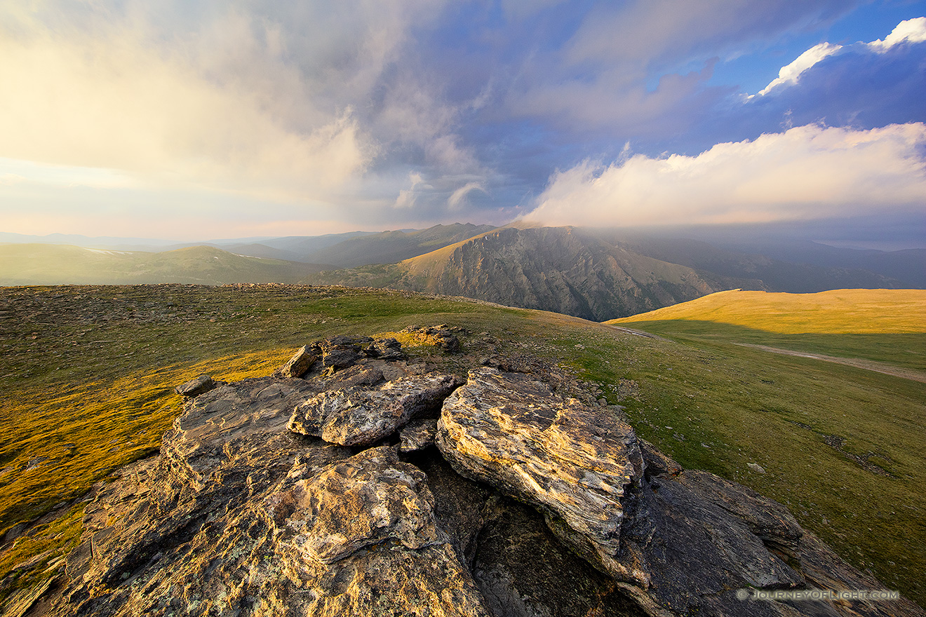 For almost an hour I watched as the clouds danced along the tops of the Mummy Range in the northern area of Rocky Mountain National Park.  The sun slowly set in the west casting long shadows along the tundra. - Colorado Picture