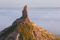 A scenic landscape photograph of Chimney Rock National Historic Site in fog. - Nebraska Photography