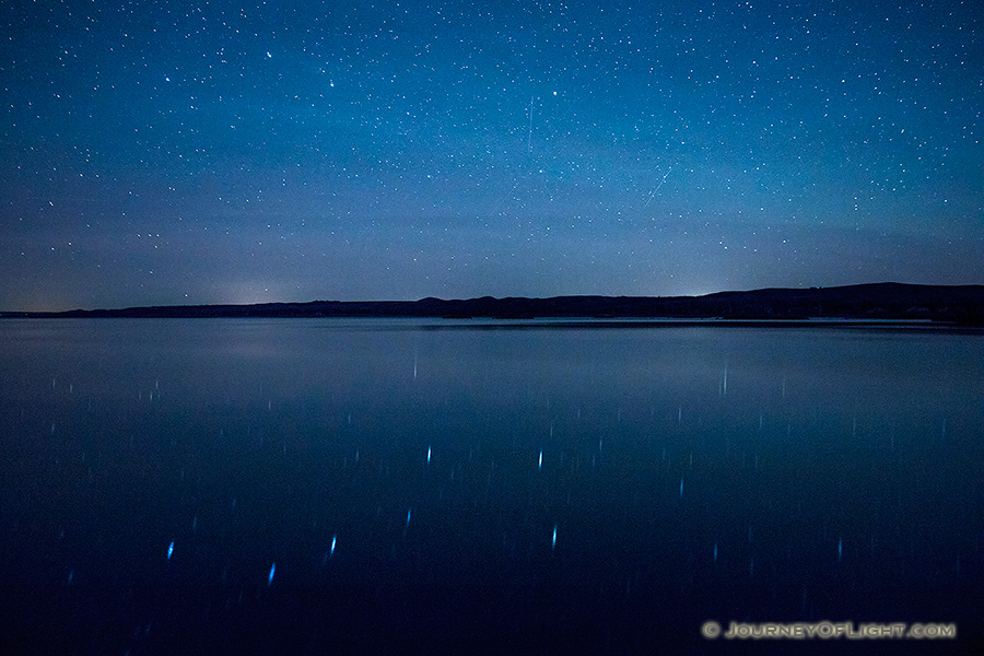 On a clear night at Niobrara State Park the stars shone brightly above the Missouri River.  In the reflection of the river the Big Dipper can be clearly seen. - Nebraska Photography