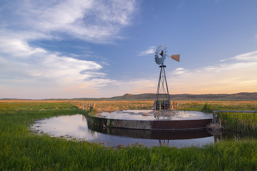 On a breezy evening in Crescent Lake National Wildlife Refuge a windmill stands like a sentinel among the sandhills. - Nebraska Photography