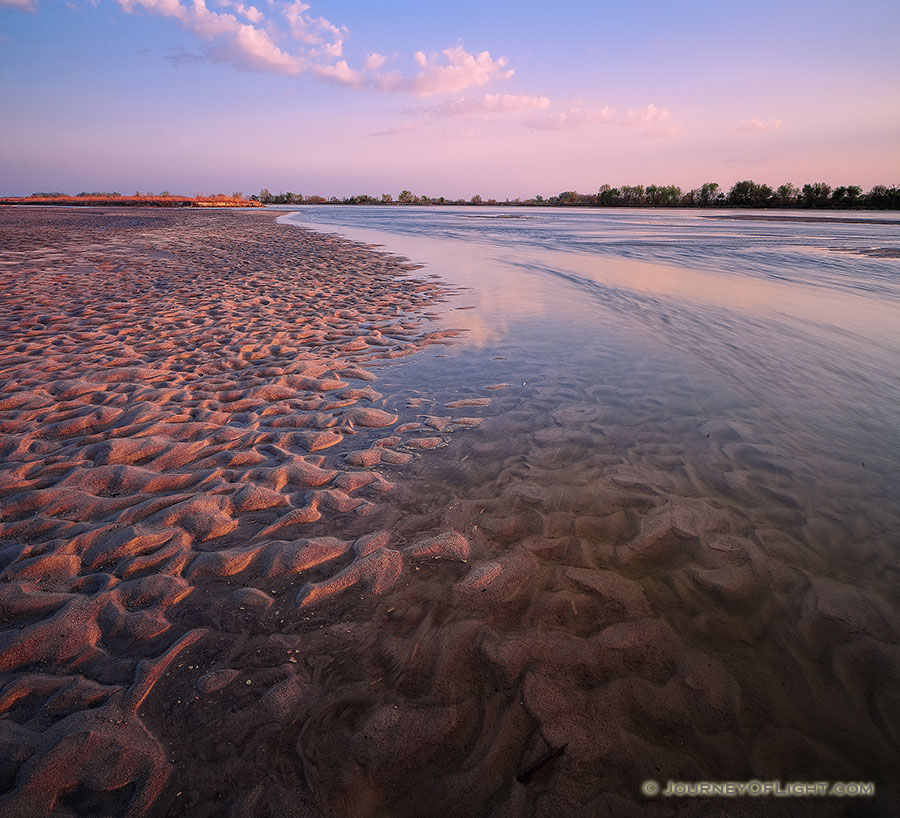 On a sandbar near Two Rivers State Recreation Area, the Platte River flows into the distance as the sun sets to the west. - Nebraska Photography