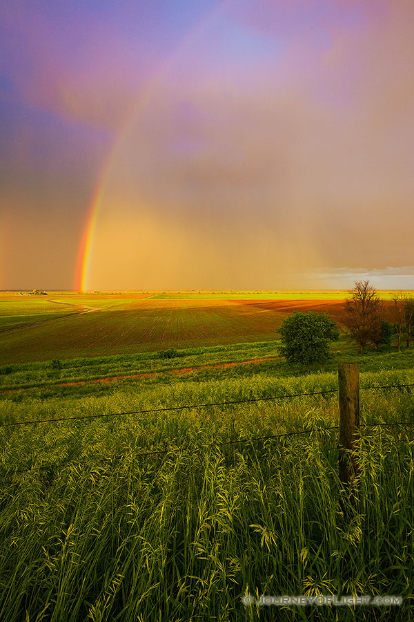After a rain storm a stunning rainbow touches the ground on the Missouri Valley plains. - Nebraska Photography