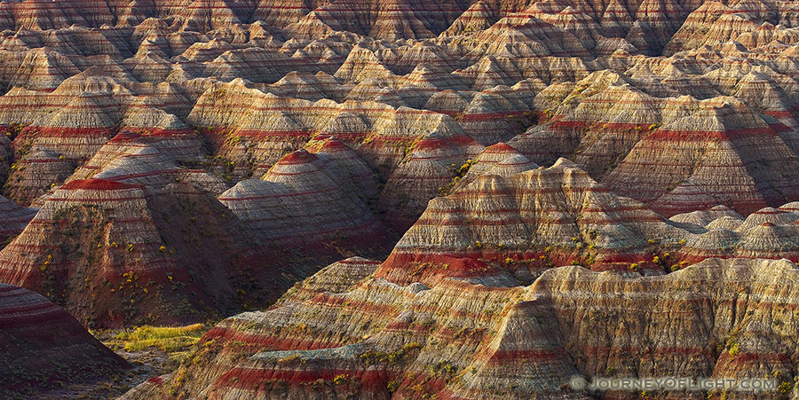 A section of the Badlands in South Dakota glow with the warmth of the pre-risen sun. - South Dakota Photography