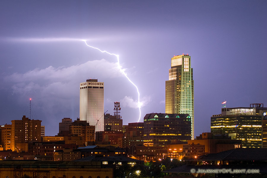 While setting up to capture the 9/11 tribute in downtown Omaha I instead witnessed a spectacular fall storm.  I managed to capture this lightning between the Woodmen Tower and the First National Bank Tower. - Omaha Photography