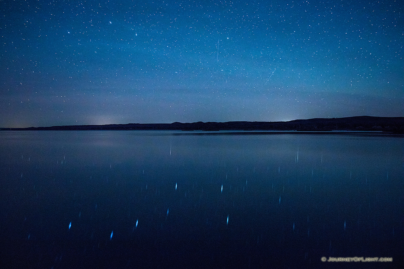 On a clear night at Niobrara State Park the stars shone brightly above the Missouri River.  In the reflection of the river the Big Dipper can be clearly seen. - Nebraska Picture