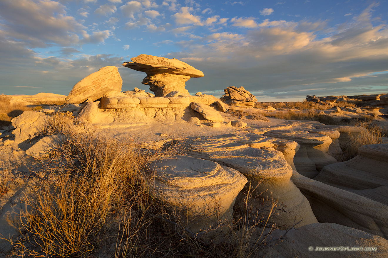 Scenic landscape photograph of Toadstool Geologic Park in western Nebraska at dusk. - Nebraska Picture