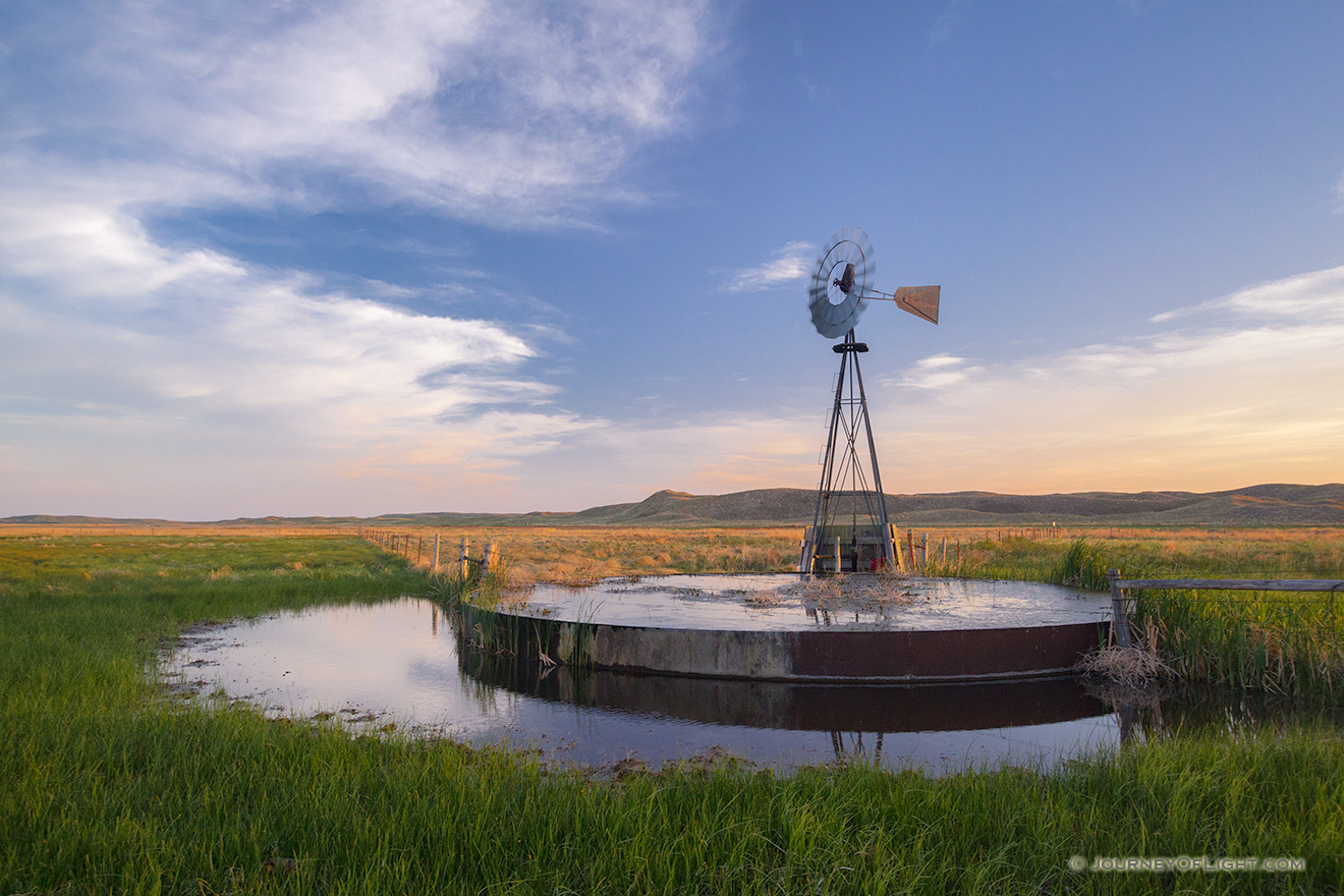On a breezy evening in Crescent Lake National Wildlife Refuge a windmill stands like a sentinel among the sandhills. - Nebraska Picture