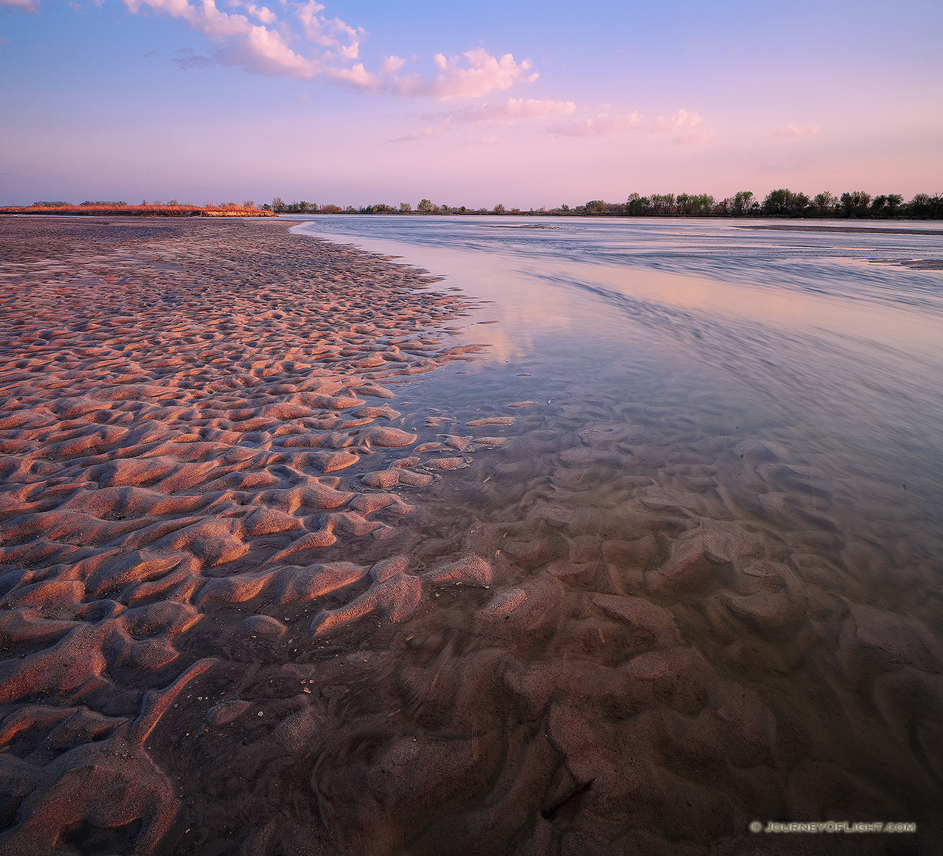 On a sandbar near Two Rivers State Recreation Area, the Platte River flows into the distance as the sun sets to the west. - Nebraska Picture