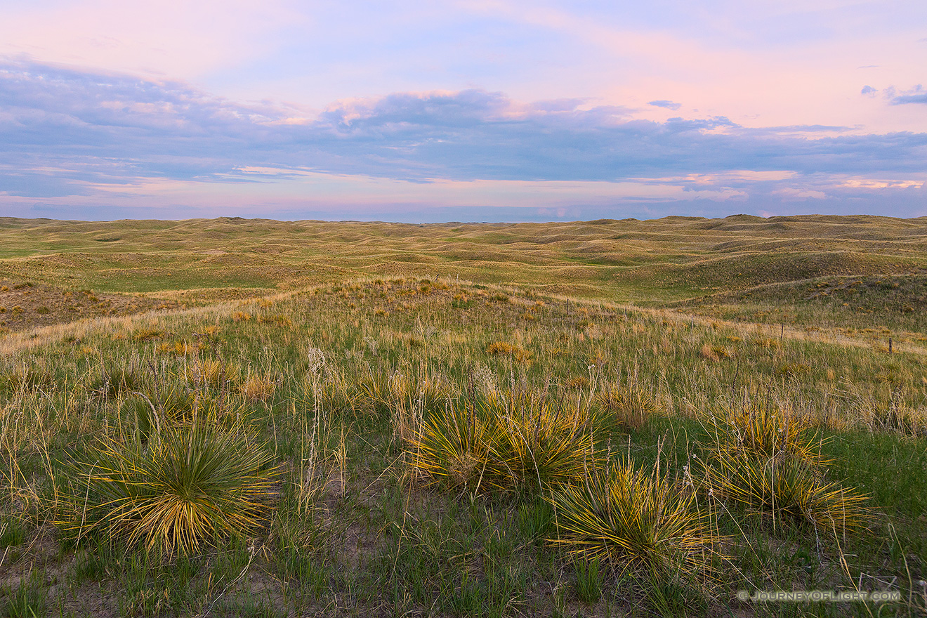 As twilight descends, a calm comes over an expanse of the sandhills in Cherry County, Nebraska. - Nebraska Picture