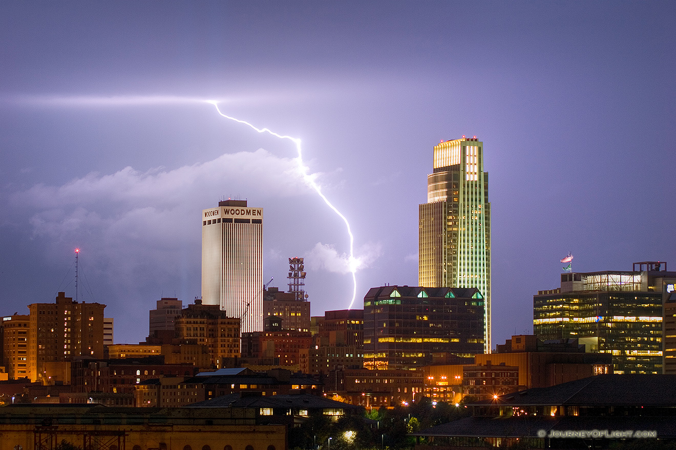 While setting up to capture the 9/11 tribute in downtown Omaha I instead witnessed a spectacular fall storm.  I managed to capture this lightning between the Woodmen Tower and the First National Bank Tower. - Omaha Picture